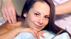 The young beautiful girl has a rest during the massage. Stock Footage