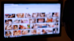 Watching porn ,Man on Internet watching, in this clips nudity are blurred Stock Footage