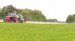 Modern farm machinery tractor with black sprayer work in field Stock Footage