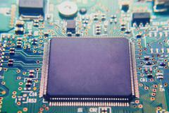 Closeup of electronic circuit board with processor Stock Photos