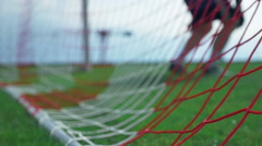 Goal keeper jumping - football game soccer player scoring Stock Footage
