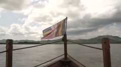 Buddha flag on front of boat Stock Footage