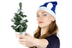 Woman with small christmas fir tree Stock Photos