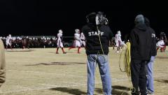 Cameramen filming football game Stock Footage