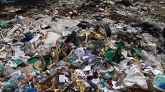 Garbage at landfill Stock Footage