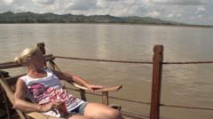 Woman is sunbathing on boat Stock Footage