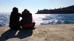 Young loving couple enjoying  beautiful sea scape Stock Footage