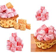 turkish sweet delights in icing sugar in the basket isolated - stock photo