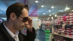 Man thinks about store windows Stock Footage