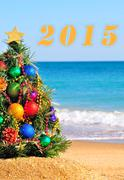 Christmas tree on the sand in the beach Stock Illustration