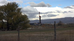 Oil well drilling exploration rural farm land HD 065 Stock Footage