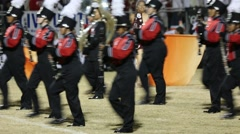 Band Marches in Formation with Color Guard in Background Stock Footage