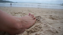 Woman feet digging sand on the beach Stock Footage