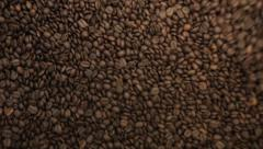Coffee beans in the roasting machine. Selective focus. Copy space Stock Footage