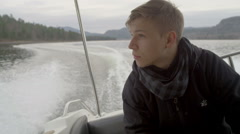 Young man floating on a boat on the lake Stock Footage