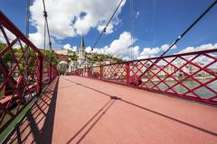 Stock Photo of view of lyon city from red footbridge