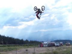 FMX professional backflip, cloudy day. Stock Footage