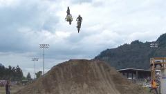 2 FMX professionals jumping. Stock Footage