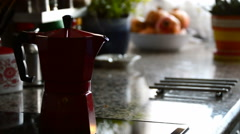 Red moka coffee making coffee in domestic kitchen - stock footage