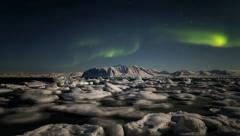 Arctic Magic Lights over the freezing fjord (Aurora Borealis) Stock Footage