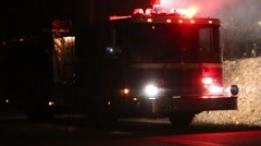 Firetruck with Emergency Lights and Spotlight on Smoking Woods - stock footage