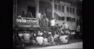 Sick and injured POW's and Filipino civilians relaxing in front of hospital Stock Footage