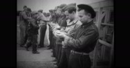 Military soldiers in a row receiving war pigeons Stock Footage