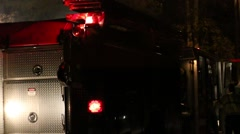 Fireman Enters Firetruck with Lights Stock Footage