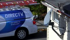 DIRECTV Dish installed on home - stock footage