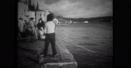 Fishermen pulling fishing nets at dock Stock Footage