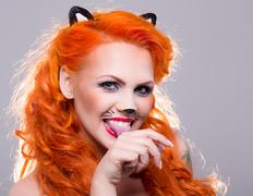 Cat woman with red hair - stock photo