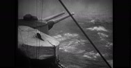 View of warship cannon firing and ship being scuttled Stock Footage