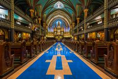 Interior of Notre-Dame cathedral and its altar in Montreal, Canada Stock Photos
