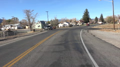 Entering small rural town drive POV HD 002 Stock Footage