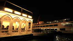 Port, berth, quay, illuminate, lit, spotlit passenger ferry commuter walk golden Stock Footage
