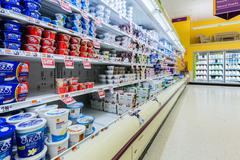Cultured dairy products aisle in an American supermarket. - stock photo