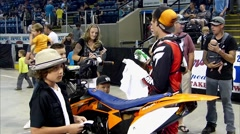 Stock Video Footage of FMX rider signs autographs.