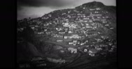 View of houses on mountain side hill Stock Footage