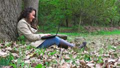 4k happy teen model with laptop in the  fall park, sony uhd steadycam shoot, Stock Footage