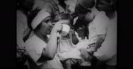 Public health nurses feeding children Stock Footage