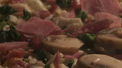 Time lapse pan shot pizza with ham and mushrooms Stock Footage