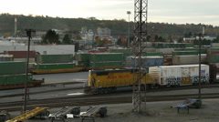 A Train Rolls Down the Tracks In Rail Yard - stock footage