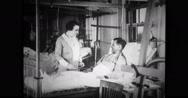 Public health nurse assisting a patient Stock Footage