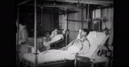Public health nurse and nun assisting a patient Stock Footage