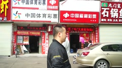 Shenzhen, China: sports lottery and the welfare lottery store - stock footage