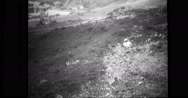 View of bomb hole and damaged truck at Dutch harbour after Japanese attack Stock Footage