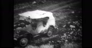 Wreckage of military truck and bomb hole at Dutch harbour Stock Footage