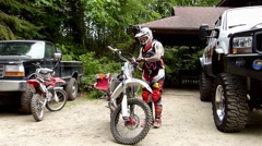 FMX Riders suiting up, 2 scenes Stock Footage