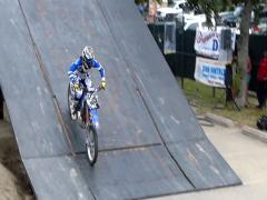 FMX 4 jump train, professional riders Stock Footage