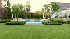 Beautiful Pool And Manicured Lawn Stock Footage
